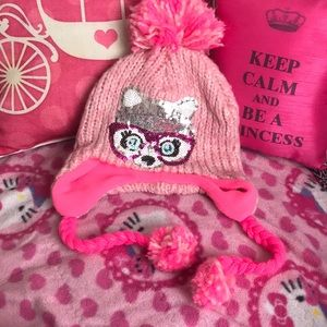 Pink stocking hat with sequined raccoon